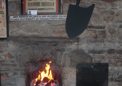 Enjoy a seat by the fire at Mellett's Emporium Swinford Co Mayo